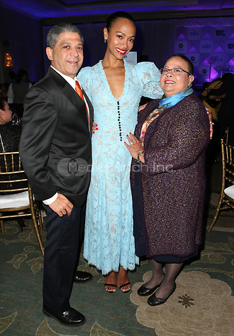LOS ANGELES, CA - NOVEMBER 8: Zoe Saldana with  parents Dagoberto Galan and Asalia Nazario at the Eva Longoria Foundation Dinner Gala honoring Zoe Saldaña and Gina Rodriguez at The Four Seasons Beverly Hills in Los Angeles, California on November 8, 2018. Credit: Faye Sadou/MediaPunch