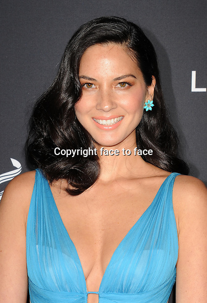 BEVERLY HILLS, CA- FEBRUARY 22: Actress Olivia Munn arrives at the 16th Costume Designers Guild Awards at The Beverly Hilton Hotel on February 22, 2014 in Beverly Hills, California.<br />