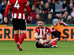 Enda Stevens of Sheffield Utd injured during the Premier League match at Bramall Lane, Sheffield. Picture date: 7th March 2020. Picture credit should read: Simon Bellis/Sportimage