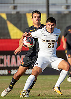 COLLEGE PARK, MD - NOVEMBER 03: Marc Ybarra #23 of Michigan shields the ball from David Kovacic #6 of Maryland during a game between Michigan and Maryland at Ludwig Field on November 03, 2019 in College Park, Maryland.