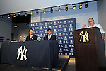 Hideki Matsui,<br /> JULY 28, 2013 - MLB :<br /> Hideki Matsui watches New York Yankees general manager Brian Cashman next to his interpreter Roger Kahlon during a press conference for signing a one-day minor league contract with the Yankees prior to his official retirement ceremony before the Major League Baseball game against the Tampa Bay Rays at Yankee Stadium in The Bronx, New York, United States. (Photo by AFLO)
