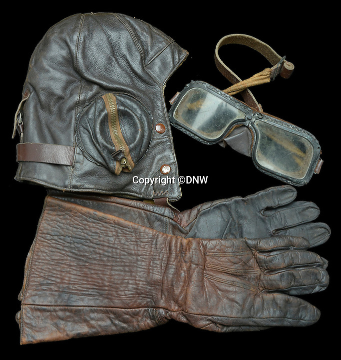 BNPS.co.uk (01202 558833)<br /> Pic: DNW/BNPS<br /> <br /> Flt Sgt Stephen Burns helmet, goggles and gauntlets were returned to the family after the war.<br /> <br /> An incredibly poignant poem left by a grieving mother in her war hero son's flying log book has been uncovered to reveal the devastation his death had on her.<br /> <br /> Sarah Burns was so heartbroken at the loss of son Stephen - who flew on the famous Dambusters Raid - that she slept with his spare RAF uniform for solace.<br /> <br /> She also penned a touching poem in his logbook alongside the signatures of RAF legends Guy Gibson and Sir Leonard Cheshire. The items are now being sold by Dix Noonan Webb.