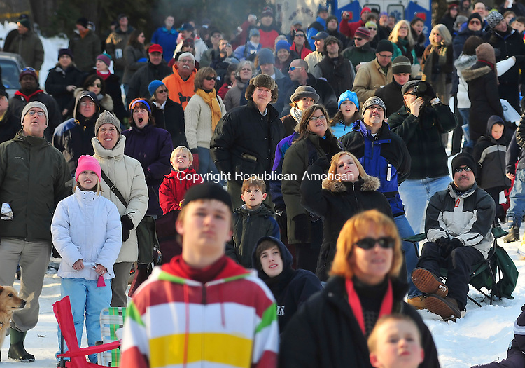 SALISBURY, CT- 07 February 2009 --020709JS16-Spectators look on as skiers jump on Saturday at Satre Hill in Salisbury during the Salisbury Winster Sports Association Jump Fest 2009. The event continues today with the U.S. Eastern National Chapionships. <br /> Jim Shannon / Republican-American