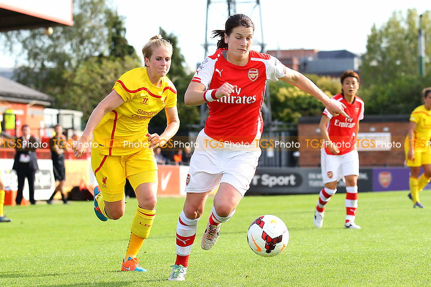 Niamh Fahey of Arsenal Ladies evades Natasha Dowie of Liverpool Ladies - Arsenal Ladies vs Liverpool Ladies - FA Womens Super League Football at Meadow Park, Boreham Wood FC  - 05/10/14 - MANDATORY CREDIT: Gavin Ellis/TGSPHOTO - Self billing applies where appropriate - contact@tgsphoto.co.uk - NO UNPAID USE