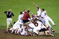 The South Carolina Gamecocks dogpile after winning the NCAA Division One Men's College World Series on June 29th, 2010 at Johnny Rosenblatt Stadium in Omaha, Nebraska.  (Photo by Andrew Woolley / Four Seam Images)