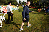 Washington, DC - June 25, 2009 -- White House Press Secretary Robert Gibbs walks out toward a dunk tank before being soaked by members of the news media before a luau for members of Congress and their families on the South Lawn of the White House June 25, 2009 in Washington, DC. In a celebration of U.S. President Barak Obama's home state, the South Lawn was decorated with tiki torches and palm huts and the meal prepared by famous Hawaiian chef Alan Wong.  .Credit: Chip Somodevilla - Pool via CNP