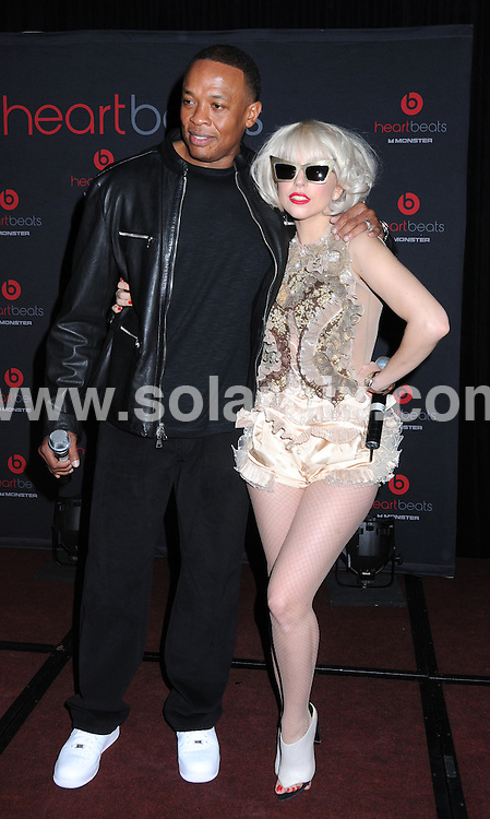 """**ALL ROUND PICTURES FROM SOLARPIX.COM**.**SYNDICATION RIGHTS FOR UK, AUSTRALIA, DENMARK, PORTUGAL, S. AFRICA, SPAIN & DUBAI (U.A.E) ONLY**.Lady GaGa and Dr Dre arrive for """"Heartbeats"""" Monster Headphones launch party at The Palace Hotel in New York City, USA. The headphones were Designed by Lady GaGa Palace Hotel - New York City, NY, USA.This pic:  Lady GaGa & Dr Dre.JOB REF:   10043  PHZ / Mayer   DATE:  01.10.09.**MUST CREDIT SOLARPIX.COM OR DOUBLE FEE WILL BE CHARGED**.**MUST NOTIFY SOLARPIX OF ONLINE USAGE**.**CALL US ON: +34 952 811 768 or LOW RATE FROM UK 0844 617 7637**"""