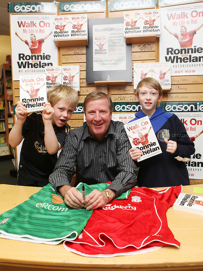 ***NO FEE PIC ***.10/09/2011.Eason Ireland's leading retailer of books , stationery, magazines & lots more hosted a book signing by former Liverpool & Irish international soccer player Ronnie Whelan..Pictured at Eason O' Connell street, Dublin is Ronnie Whelan with brothers Sean Harte (9) & Peter Harte (12) signing copies of his new autobiography WALK ON for fans..Follow Eason on twitter- @easons..Photo: Collins