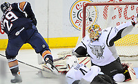 Oklahoma City Barons' Chris VandeVelde, left, scores the game-winning goal against San Antonio Rampage goaltender Jacob Markstrom during the overtime period of an AHL hockey game, Monday, May 7, 2012, in San Antonio. Oklahoma City won 2-1. (Darren Abate/pressphotointl.com)