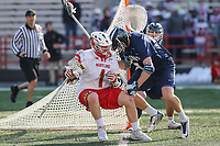 College Park, MD - March 18, 2017: Maryland Terrapins Matt Rambo (1) gets hits by Villanova Wildcats Danny Sweeney (7) during game between Villanova and Maryland at  Capital One Field at Maryland Stadium in College Park, MD.  (Photo by Elliott Brown/Media Images International)