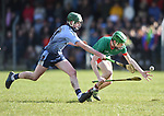 Michael Hynes of Scariff Community College in action against Oisin Campion of St Fergal's College during their All-Ireland Colleges final at Toomevara. Photograph by John Kelly.