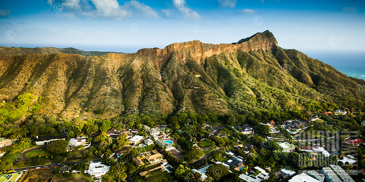 An aerial view of Diamond Head right before sunset, with luxurious mansions in foreground, Honolulu, O'ahu.