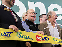 NWA Democrat-Gazette/CHARLIE KAIJO Arkansas Highway Commission member Philip Taldo (center) holds a ribbon also shown with Commission Chairman Tom Schueck (right) during a ribbon cutting, January 4, 2019 at the Jones Center in Springdale. <br /><br />State highway and local officials held a ribbon cutting to mark the opening of a new section of Arkansas 265 that will carry traffic on the north-south corridor into downtown Rogers.