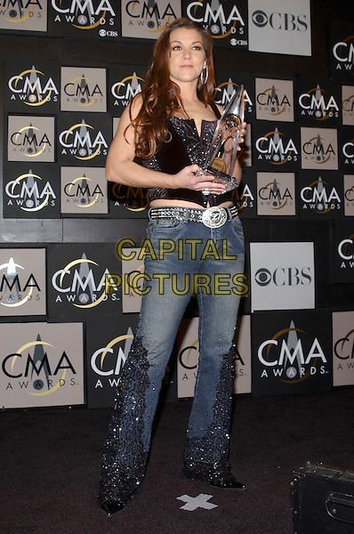 GRETCHEN WILSON.Singer Martina McBride at the 38th Annual CMA Awards held at the Grand Ole Opry, Nashville, Tennessee, USA,.November 09, 2004..full length trophy award.Ref: ADM.www.capitalpictures.com.sales@capitalpictures.com.©G.Shepherd/AdMedia/Capital Pictures .