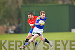 Sean O'Connell St Senans goes past Sean O'Sullivan Kilgarvan during their Novice Championship clash in Kilgarvan on Saturday