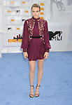 LOS ANGELES, CA - APRIL 12: Model Cara Delevingne arrives at the 2015 MTV Movie Awards at Nokia Theatre L.A. Live on April 12, 2015 in Los Angeles, California.