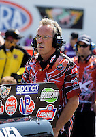 Aug. 30, 2013; Clermont, IN, USA: A crew member for NHRA top alcohol funny car driver Cassie Simonton during qualifying for the US Nationals at Lucas Oil Raceway. Mandatory Credit: Mark J. Rebilas-USA TODAY Sports