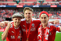 Harry Chapman of Barnsley (left) Marc Roberts and George Williams of Barnsley celebrating after winning the Johnstone's Paint Trophy Final match between Oxford United and Barnsley at Wembley Stadium, London, England on 3 April 2016. Photo by Alan  Stanford / PRiME Media Images.
