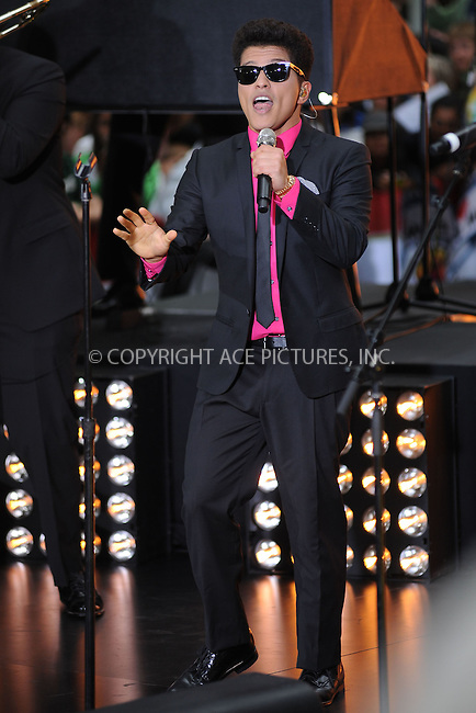 WWW.ACEPIXS.COM . . . . . .June 23, 2011...New York City...Bruno Mars performs on NBC's 'Today' at Rockefeller Center on June 23, 2011 in New York City.....Please byline: KRISTIN CALLAHAN - ACEPIXS.COM.. . . . . . ..Ace Pictures, Inc: ..tel: (212) 243 8787 or (646) 769 0430..e-mail: info@acepixs.com..web: http://www.acepixs.com .