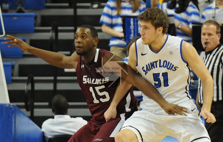 Southern Illinois Salukis forward Dantiel Daniels (15) and Saint Louis Billikens forward Rob Loe (51) under the basket in action during a non-conference game between the St. Louis University Billikens and the Southern Illinois University-Carbondale Salukis on November 24, 2012 at the Chaifetz Arena in St. Louis Missouri.  The Billikens won, 61-51.