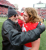 Ohio State Buckeyes offensive linesman Andrew Norwell (78) embraces a family member during Senior Day celebration before the college football game between the Ohio State Buckeyes and the Indiana Hoosiers at Ohio Stadium in Columbus, Saturday afternoon, November 23, 2013. The Ohio State Buckeyes defeated the Indiana Hoosiers 42 - 14. (The Columbus Dispatch / Eamon Queeney)