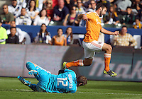 CARSON, CA - DECEMBER 01, 2012:   Josh Saunders (12) of the Los Angeles Galaxy stops Will Bruin (12) of the Houston Dynamo during the 2012 MLS Cup at the Home Depot Center, in Carson, California on December 01, 2012. The Galaxy won 3-1.