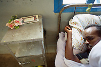 Somaliland. Waqohi Galbed province. Hargeisa. Tubeculosis (TB) hospital. Male ward. A black muslim man, TB patient, rests in his bed while he takes the two months drugs as a TB treatment. A platic rose is laid on the metal bedside table. The Global Fund through the ngo ( Non-governmental organization ) World Vision supports the programm with a Tuberculosis grant (financial aid). Somaliland is an unrecognized de facto sovereign state located in the Horn of Africa. Hargeisa is the capital of Somaliland. © 2006 Didier Ruef