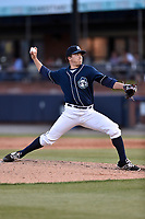 Asheville Tourists pitcher Matt Dennis (30) delivers a pitch during a game against the Greenville Drive at McCormick Field on April 15, 2017 in Asheville, North Carolina. The Tourists defeated the Drive 5-4. (Tony Farlow/Four Seam Images)