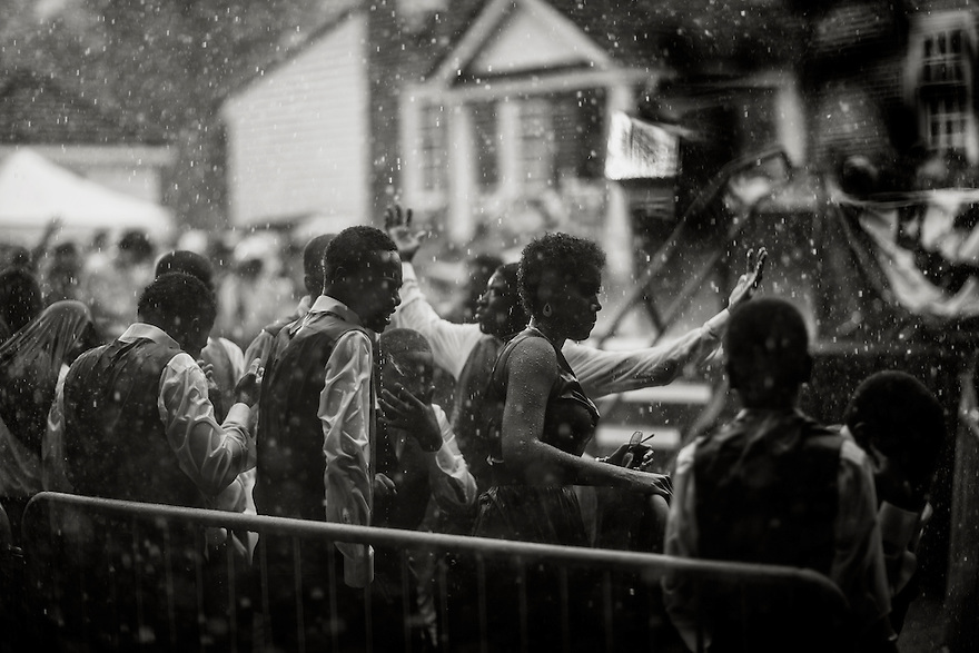 U.S. President Barack Obama speaks in the rain during a campaign rally in Glen Allen, Virginia