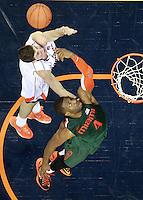 Miami forward Raphael Akpejiori (4) reaches for the rebound with Virginia guard Joe Harris (12) during an NCAA basketball game Saturday Feb, 24, 2014 in Charlottesville, VA. Virginia defeated Miami 65-40.