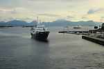 Two Hurtigruten ferry ships arriving at Molde, Norway the Lofoten is the oldest ship in the fleet