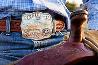 Champion belt buckle worn by Murray Thompson, World Champion for Reined Cow Horse while sitting in the saddle