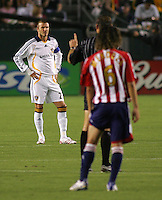 Referee Terry Vaughn talks to LA Galaxy midfielder David Beckham (23). CD Chivas USA defeated the LA Galaxy 3-0 in the Super Classico MLS match at the Home Depot Center in Carson, California, Thursday, August 23, 2007.