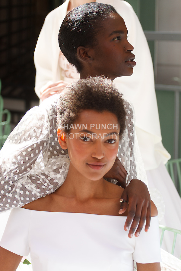 Close up of models posing bridal gowns from the Delphine Manivet Spring Summer 2017 Bridal collection at Ladurée SoHo at 76 Thompson Street, during New York Bridal Fashion Week Spring Summer 2017, on April 18, 2016.