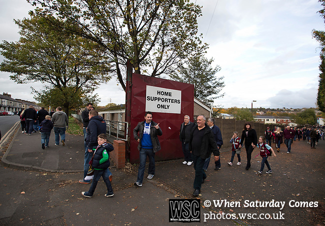 Burnley 1 West Ham United 3, 18/10/2014. Turf Moor, Premier League. Home supporters filing out of the stadium at the end of the Burnley versus West Ham United English Premier League match at Turf Moor. The fixture was won by the visitors by three goals to one watched by 18,936 spectators. The defeat meant that Burnley still had not won a league match since being promoted from the Championship the previous season. Photo by Colin McPherson.
