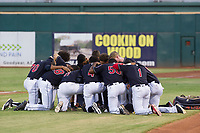 AZL Indians pray before a game against the AZL Padres on August 30, 2017 at Goodyear Ball Park in Goodyear, Arizona. AZL Padres defeated the AZL Indians 7-6. (Zachary Lucy/Four Seam Images)