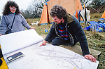 Protesters and local residents examining maps  and  setting up the  protest camp at Twyford down .M3 extension Winchester.
