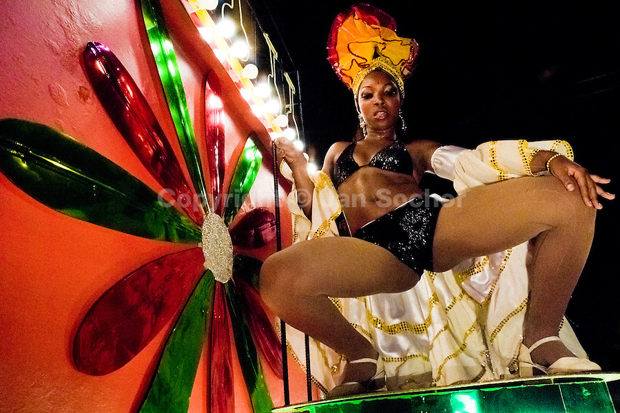 A Cuban girl performs a provocative dancing show during the Carnival in Santiago de Cuba, Cuba, 25 July 2008. Carnival in Santiago de Cuba is a large public celebration which is held - contrary to the other Latin American carnivals - in the summer. The carnival tradition dates back to the 17th century when the Spanish festival of Santiago (St. James) was mixed with street dancing parades of the Black African slaves. Nowadays comparsas, carnival groups of dancers and musicians, flow in the streets and perform popular music like salsa, rumba or reggaeton. In spite of the general lack of funds in Cuba (most of the festival costumes and floats are home-made) the Carnival is very lively and hot show with huge participation of the people of Santiago de Cuba.