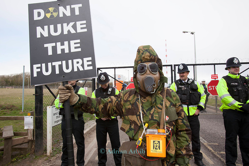 A masked protester  and a 'don't nuke the future ' placard at a march against the building of  Hinkley C power station, Somerset ,  and the UK government's choice of Nuclear power as the mainstay of England's power supply.<br /> Around 1000 people attended.<br /> 10 th March 2012<br /> <br /> though planning has been granted 19/3/2013 it remains  doubtful that a strike price can be agreed.