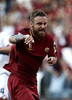 Calcio, Serie A: Roma, stadio Olimpico, 28 maggio 2017.<br /> AS Roma's Daniele De Rossi celebrates after scoring during the Italian Serie A football match between AS Roma and Genoa at Rome's Olympic stadium, May 28, 2017.<br /> Francesco Totti's final match with Roma after a 25-season career with his hometown club.<br /> UPDATE IMAGES PRESS/Isabella Bonotto