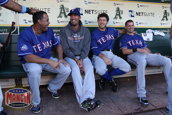 OAKLAND, CA - JULY 17:  Nelson Cruz #17, Mike Adams #37, Ian Kinsler #5, and Michael Young #10 of the Texas Rangers laugh in the dugout before the game against the Oakland Athletics at O.co Coliseum on Tuesday, July 17, 2012 in Oakland, California. Photo by Brad Mangin