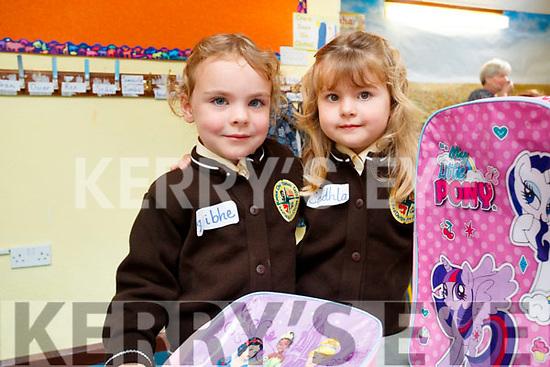 Twins Aoibhe agus Cadhla Ní Fhearíosa, enjoying their first day of school at Gaelscoil Mhic Easmainn, Tralee, on Wednesday morning last.