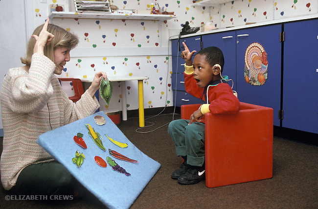 Berkeley CA Speech therapist signing with deaf boy, three years old, at Center for the Education of the Infant Deaf,