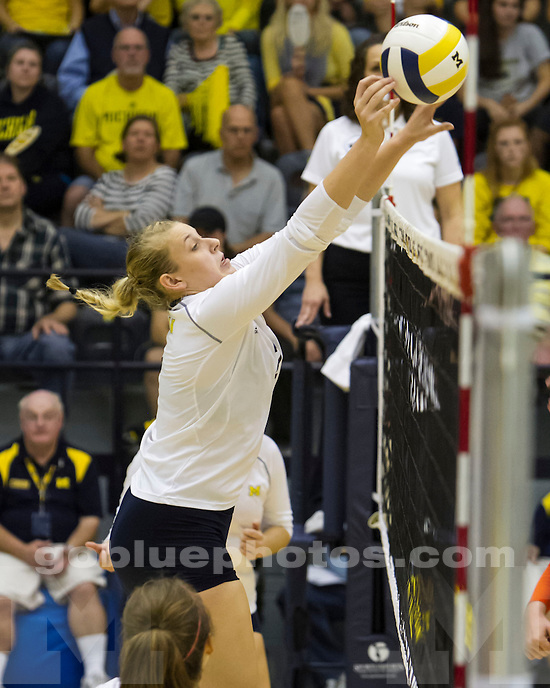The University of Michigan womens volleyball team; 3-2 loss to  Illinois at Cliff Keen in Ann Arbor MI. on October 5,2013.