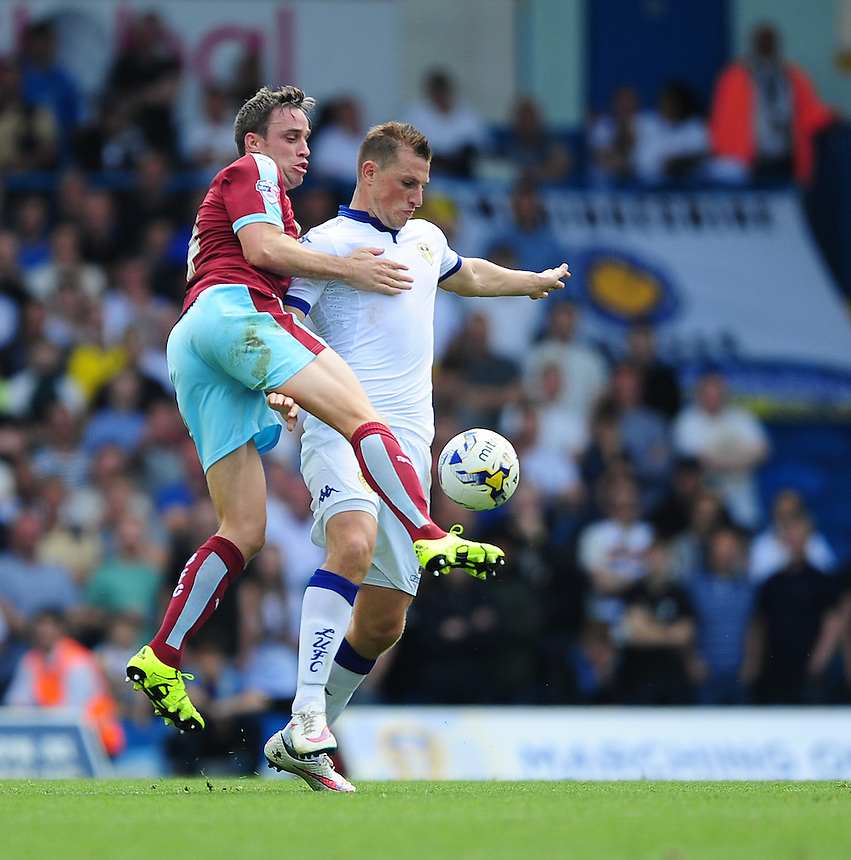 Leeds United's Chris Wood is tackled by Burnley's Michael Duff<br /> <br /> Photographer Chris Vaughan/CameraSport<br /> <br /> Football - The Football League Sky Bet Championship - Leeds United  v Burnley - Saturday 8th August 2015 - Elland Road - Beeston - Leeds<br /> <br /> &copy; CameraSport - 43 Linden Ave. Countesthorpe. Leicester. England. LE8 5PG - Tel: +44 (0) 116 277 4147 - admin@camerasport.com - www.camerasport.com