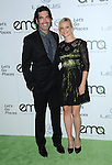 Amy Smart and Carter Oosterhouse arriving to the 23rd Annual Environmental Media Awards held at Warner Brothers Studio Burbank October 19, 2013