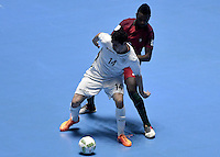 CALI -COLOMBIA-01-10-2016: Mahdi Javid (Izq) jugador de Irán disputa el balón con Djo (Der) jugador de Argentina durante partido por la final de la Copa Mundial de Futsal de la FIFA Colombia 2016 jugado en el Coliseo del Pueblo en Cali, Colombia. /  Mahdi Javid (L) player of Argentina fights the ball with Djo (R) player of Portugal during match of semifinal of the FIFA Futsal World Cup Colombia 2016 played at Metropolitan Coliseo del Pueblo in Cali, Colombia. Photo: VizzorImage/ Gabriel Aponte / Staff