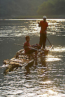 LAOS, river Nam Ou, a branch of Mekong, people travel with bamboo float / LAOS, Fluss Nam Ou , ein Nebenfluss des Mekong, Menschen fahren mit einem Bambusfloss