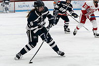 BOSTON, MA - FEBRUARY 16: Grace Middleton #6 of University of New Hampshire passes the puck during a game between University of New Hampshire and Boston University at Walter Brown Arena on February 16, 2020 in Boston, Massachusetts.