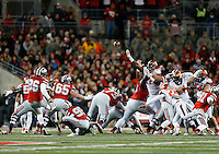 Ohio State Buckeyes place kicker Sean Nuernberger (96) kicks a field goal in the first quarter the college football game between the Ohio State Buckeyes and the Illinois Fighting Illini at Ohio Stadium in Columbus, Saturday night, November 1, 2014. The Ohio State Buckeyes defeated the Illinois Fighting Illini 55 - 14. (The Columbus Dispatch / Eamon Queeney)